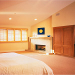 Interior_Spacious_bedroom_with_a_fireplace_009425_